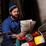 pa on bike readin paper